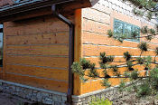 Hand_Hewn_Log_Siding_1